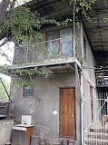 Продаётся дом в кибрайском районе 12соток, 2дома, баня, гараж, бассейн.